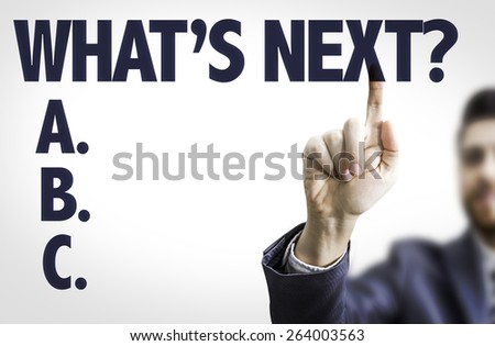 Business man pointing the text: What's Next? - stock photo