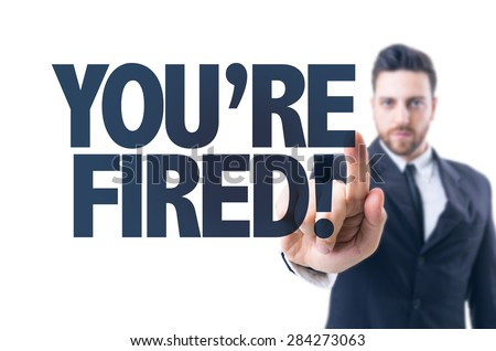Business man pointing the text: You're Fired! - stock photo