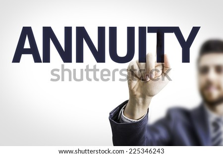 Business man pointing to transparent board with text: Annuity - stock photo