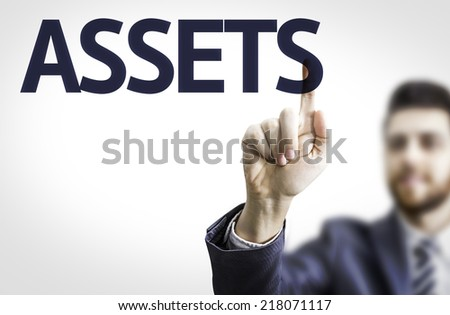 Business man pointing to transparent board with text: Assets - stock photo