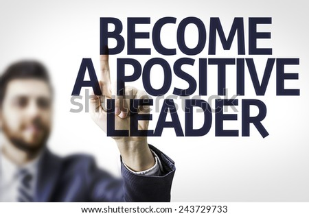 Business man pointing to transparent board with text: Become a Positive Leader - stock photo