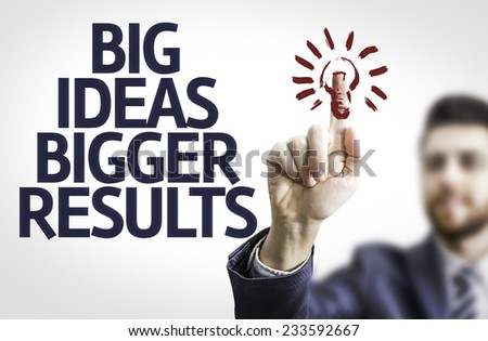 Business man pointing to transparent board with text: Big Ideas Bigger Results  - stock photo