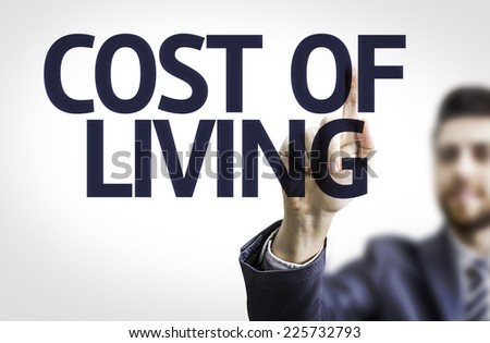Business man pointing to transparent board with text: Cost of Living - stock photo