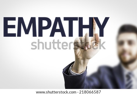 Business man pointing to transparent board with text: Empathy - stock photo