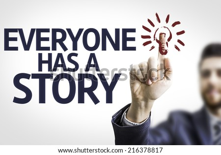 Business man pointing to transparent board with text: Everyone Has a Story - stock photo