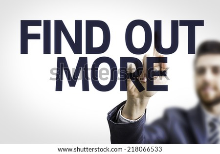 Business man pointing to transparent board with text: Find Out More - stock photo