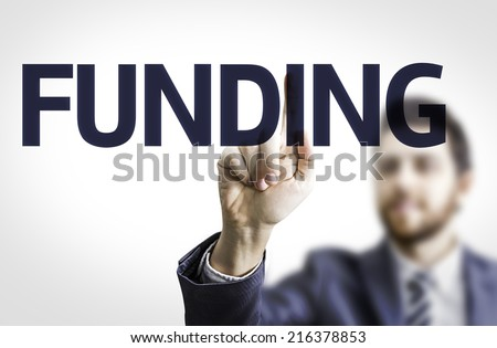 Business man pointing to transparent board with text: Funding - stock photo