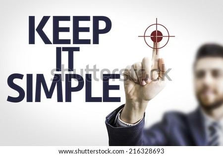 Business man pointing to transparent board with text: Keep It Simple - stock photo
