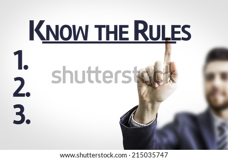 Business man pointing to transparent board with text: Know the Rules  - stock photo