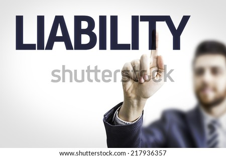 Business man pointing to transparent board with text: Liability - stock photo