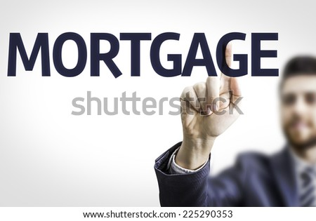 Business man pointing to transparent board with text: Mortgage - stock photo