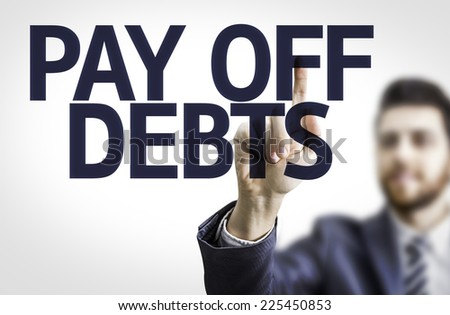 Business man pointing to transparent board with text: Pay Off Debts - stock photo