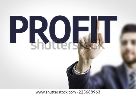 Business man pointing to transparent board with text: Profit - stock photo