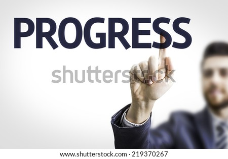 Business man pointing to transparent board with text: Progress - stock photo