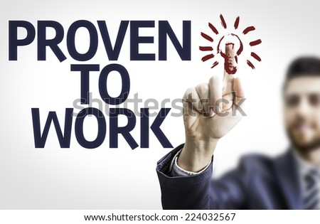 Business man pointing to transparent board with text: Proven to Work - stock photo