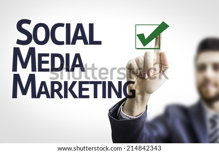 Business man pointing to transparent board with text: Social, Media, Marketing - stock photo