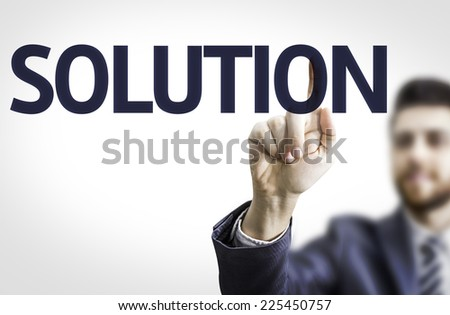 Business man pointing to transparent board with text: Solution - stock photo