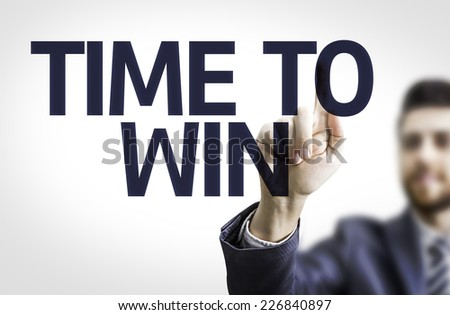 Business man pointing to transparent board with text: Time to Win - stock photo