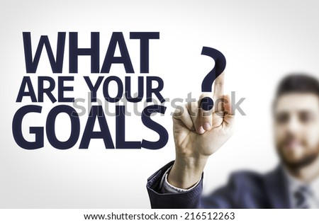 Business man pointing to transparent board with text: What are Your Goals? - stock photo