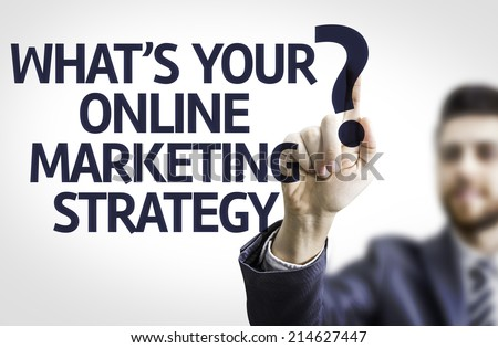 Business man pointing to transparent board with text: What's your Online Marketing Strategy? - stock photo
