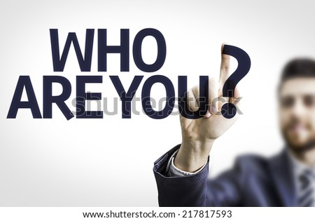 Business man pointing to transparent board with text: Who are You? - stock photo