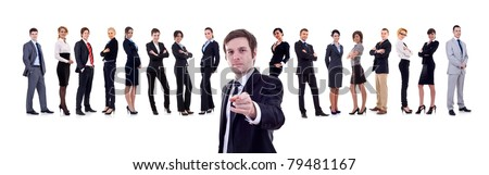 business man pointing with his team behind him - stock photo