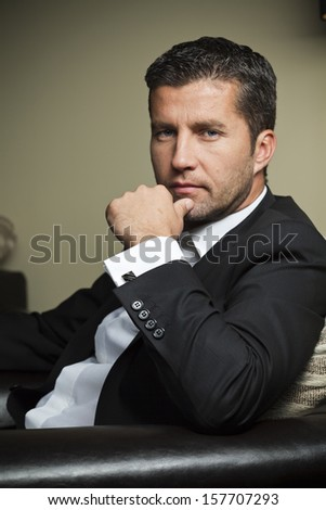 business man portrait against a dark background - stock photo