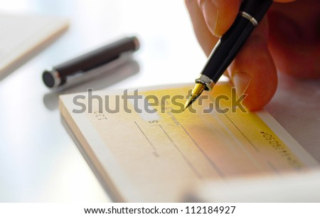 Business man prepare writing a check - stock photo