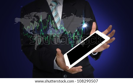 Business Man present world graph with tablet PC - stock photo