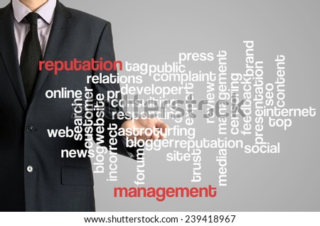 Business man presenting wordcloud related to reputation management on virtual screen - stock photo