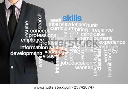 Business man presenting wordcloud related to skills on virtual screen - stock photo