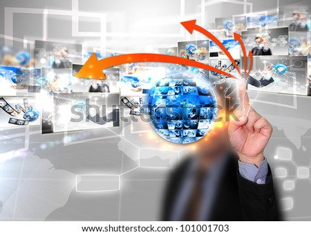 Business man press world map - stock photo