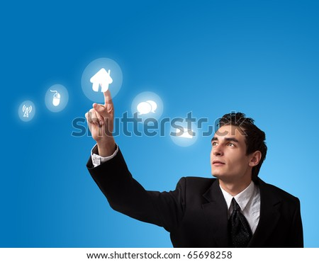 business man pressing a HOME button - stock photo