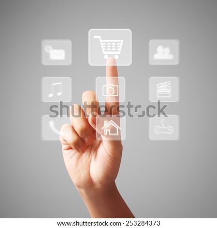 Business man pressing a touchscreen button - stock photo