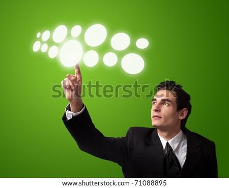 Business man pressing a touchscreen button. - stock photo