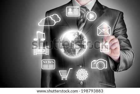 Business man pressing an icon in air - stock photo