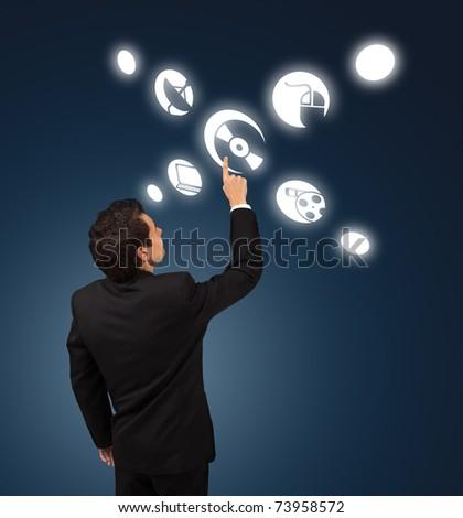 business man pressing CD / DVD button - stock photo