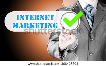 business man pressing checkbox  internet marketing - stock photo