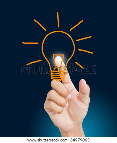 business man pressing light bulb - stock photo