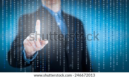 Business man pressing on button of digital virtual screen - stock photo