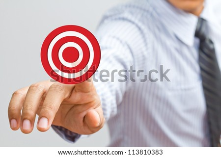Business man pressing on target goal - stock photo