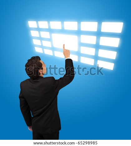 business man pressing touchscreen button - stock photo