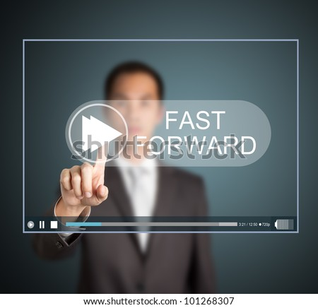 business man push fast forward button on touch screen to speed up video clip - stock photo