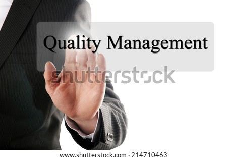 business man push the quality management button on a touch screen - stock photo