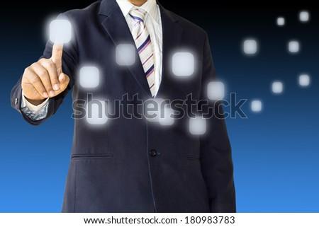 Business man pushing button - stock photo