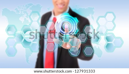 Business man pushing digital button on touch screen interface - stock photo