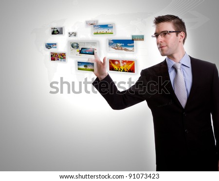 Business man pushing images streaming on a touch screen interface - stock photo