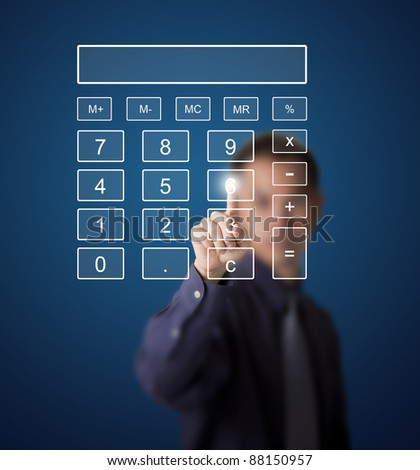 business man pushing number on touch screen digital calculator - stock photo