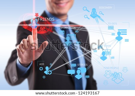 business man pushing the friends button on a social network application screen - stock photo