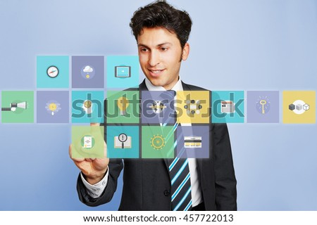 Business man pushing virtual brain icon button on a touchscreen - stock photo